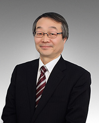 小尾仁公証人の写真
